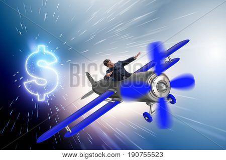 Businessman flying on vintage old airplane