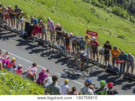 Pas de Peyrol France - July 62016: The French cyclist Florian Vachon of Fortuneo-Vital Concept Team riding on the road to Pas de Pyerol (Puy Mary) in Cantalin the Central Massif during the stage 5 of Tour de France on July 6 2016.