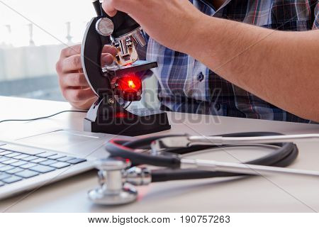 High precision engineering with man working with microscope