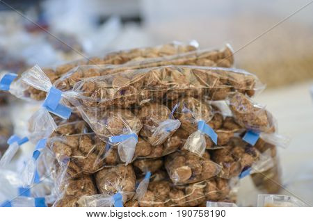 Packets Of Sugared Almonds On A Market.