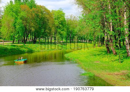VITEBSK BELARUS - MAY 21 2017: Unknown people ride on catamaran on Vitba river in park of culture and rest named after Frunze Vitebsk Belarus