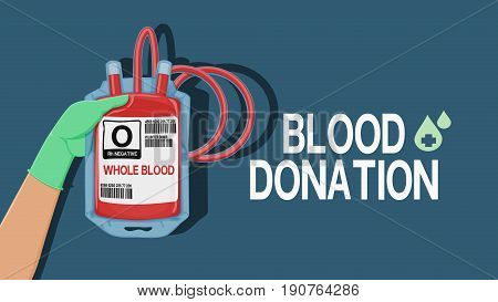 Blood donation wording with hand which is holding the blood pouch