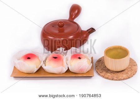 Japanese Traditional Sweets (Wagashi) ,made of mochi, anko, and fruits,Wagashi are typically made from plant ingredients with green tea  and teapot on white background.