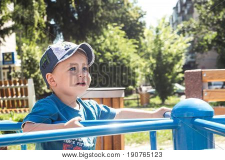 Little boy is riding a carousel summer emothions