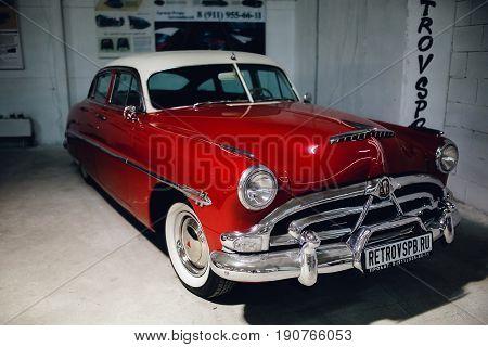 ST PETERSBURG RUSSIA - JUNE 1 2017: 1952 Hudson Hornet Sedan red car old classic retro auto era great gatsby