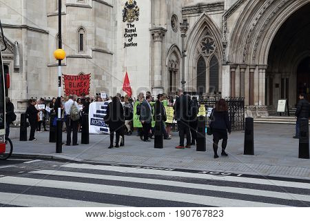 LONDON, GREAT BRITAIN - SEPTEMBER 19, 2014: This is a demonstration at the entrance to the building of The Royal Courts of Justice.