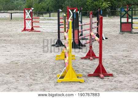 Colorful image of show jumping hurdles at the show jumping arena