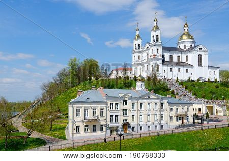 Beautiful spring view of Holy Dormition Cathedral on Assumption Mount and Holy Spirit Monastery at river Western Dvina Vitebsk Belarus