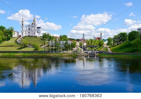 Beautiful view of historical center of Vitebsk over Western Dvina Belarus. Holy Dormition Cathedral Holy Spirit Monastery Resurrection Church and Town Hall