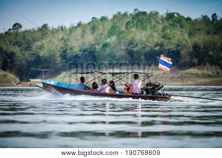 Thai boat with passengers in the lake