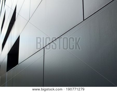 grey metallic cladding on  a modern industrial building