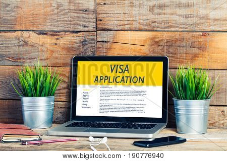 Visa Application in a laptop computer in a workplace.