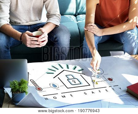 Designer meeting with illustration of smart house invention