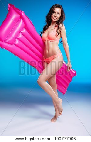 Smiling Young Woman In Bikini Posing With Air Mattress And Looking At Camera