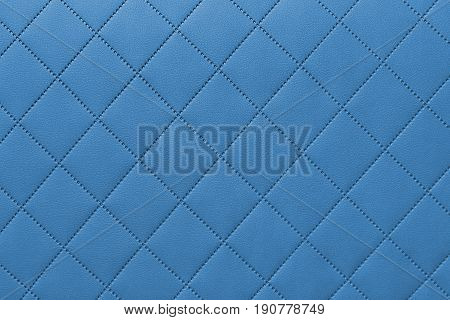 detail of sewn leather blue leather upholstery background pattern