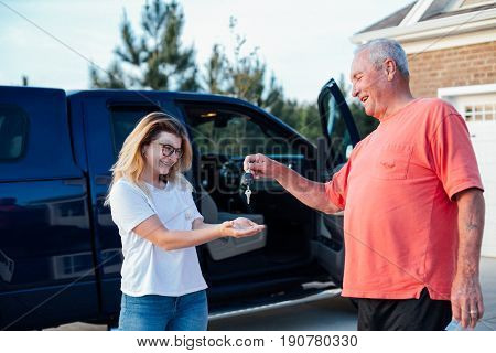 Proud grandfather gives present to his granddaughter a brand new american truck her first driving lessons class growing up teenager