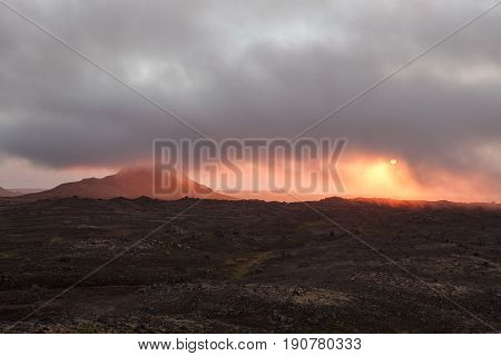 Beautiful Sunset In Empty Lava Field In Iceland. Deserted Lava Field Covered With Low Clouds. Icelan