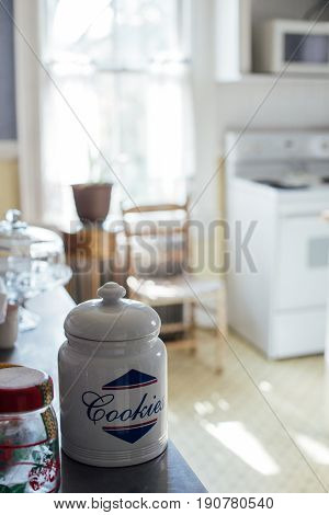 Photo of bright family american kitchen with vintage cooking electrical appliances big window with sunlight and cookie jar concept home cosy traditional values
