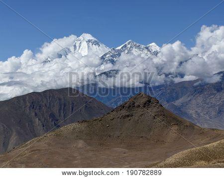 Snow capped mountain Dhaulagiri from Muktinath's desert - Annapurna Circuit trek in Nepal
