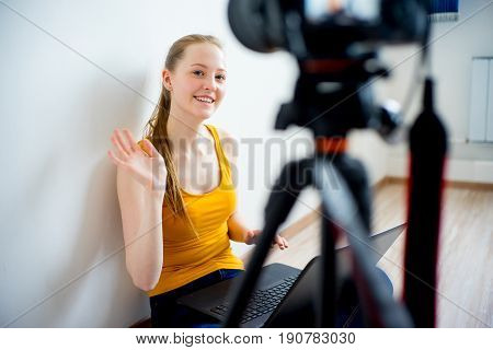 Female video blogger making video at home