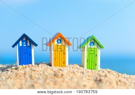 Colorful little wooden cabins at the beach