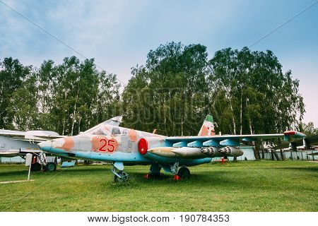 Russian Soviet Armoured Military Subsonic Attack Aircraft Fighter-bomber Stands At Aerodrome. Plane Designed To Provide Close Air Support For Troops In Fighting Day And Night In Any Weather Conditions poster
