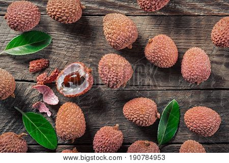 Lychees exotic fruits on a wooden background