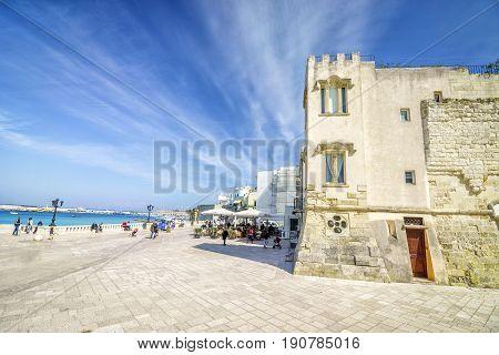 Seaside Promenade With Many Tourists In Otranto, Italy