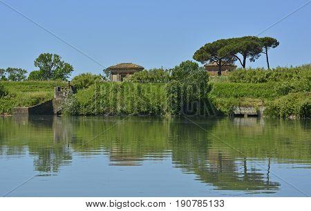 The Tiber River as it flows through Ostia Antica near Rome Italy