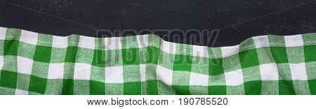 Green Checkered Tablecloth On Dark Table