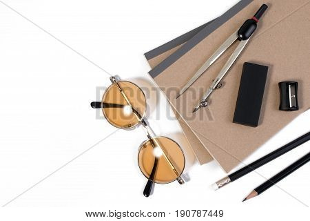 Modern White Office Desk Table With Pencil, Notebook, Divider Scriber And Glasses Or Office Supplies