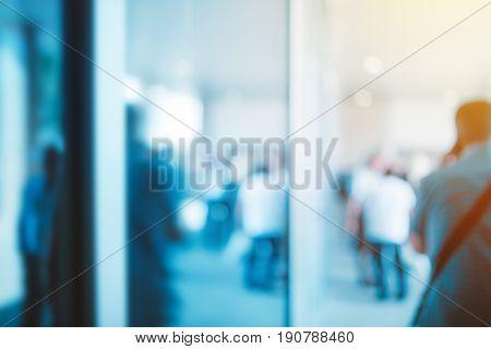 Blur business background defocussed crowd of businessmen in modern urban financial district center