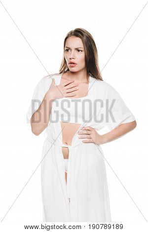 Portrait Of Young Woman In White Robe Gesturing Isolated On White