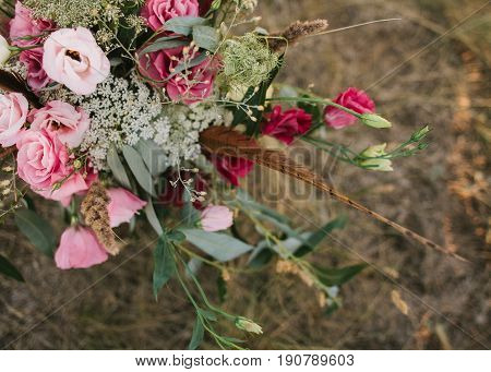 wedding flowers composition in pink , purple and claret tones as background. Bouquet from fresh roses. DOF. event, engagement concept.