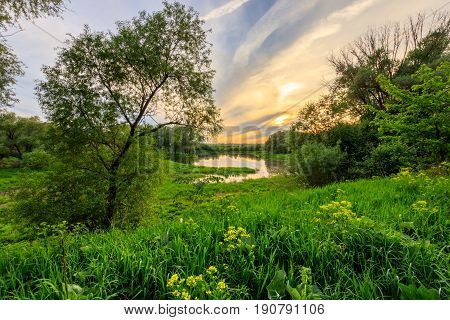 Sunset Above The Pond At Summer With Cloudy Sky Background.