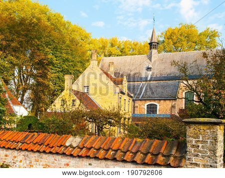 Old houses and chapel of Begijnhof, aka Beguinage, in Bruges, Belgium.