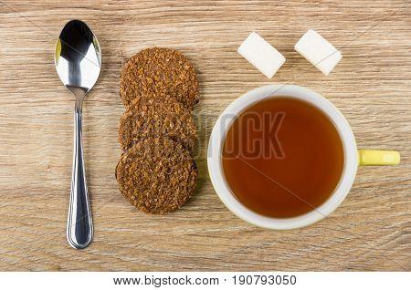 Brown Biscuits, Teaspoon, Lumpy Sugar And Cup Of Tea