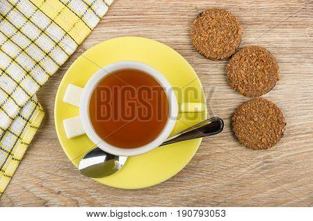 Cup Of Tea, Teaspoon, Lumpy Sugar On Saucer, Biscuits