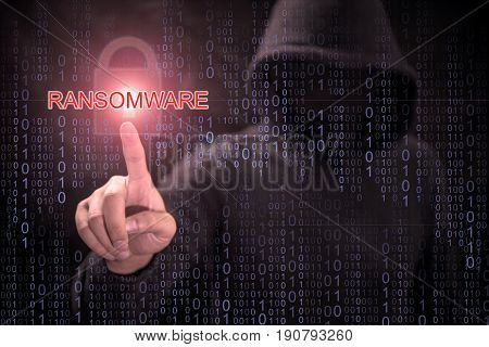 Male hacker pointing 'ransomware' and red padlock symbol in purple digital binary code background. cyber attack and internet security concepts