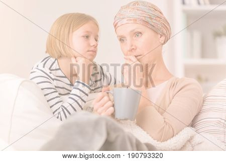 Worried mother and daughter by serious illness