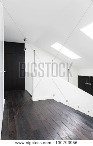 Wooden and white hallway on the first floor of big residence