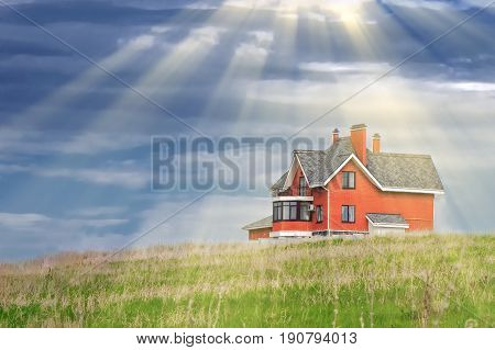House On A Background Of Blue Sky With Clouds