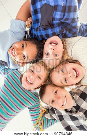 Group of young sweet children touching their heads