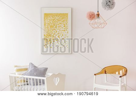 Golden Accents Decor In Newborn Room