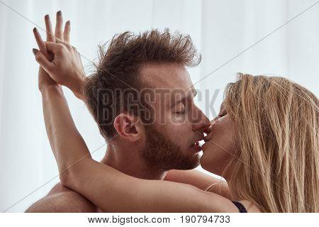 Woman Embracing And Kissing Man