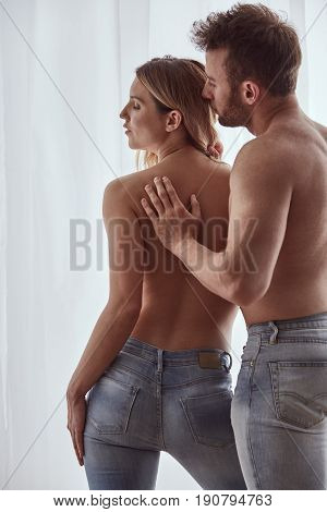 Topless Couple Wearing Jeans