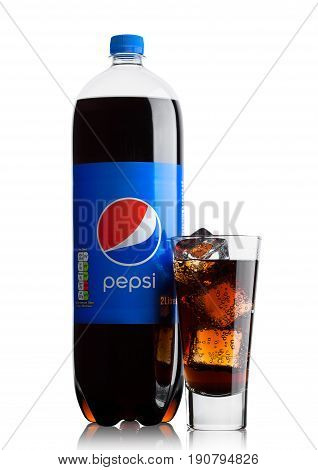 London, Uk - June 9, 2017: Bottle And Glass With Ice Cubes Of Pepsi Cola Soft Drink On White.america