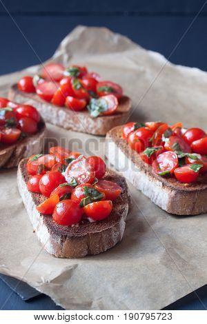 tomato bruchetta slices on a  parchment paper