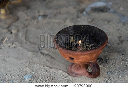 Church holy religious clay censer with burning candle. Symbol of faith pray and meditation