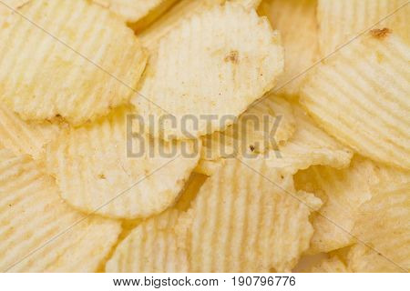 Rippled fresh organic potato chips background. Potato chips background